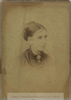 Black-and-white studio photograph (and two further copies) of Margaret Imelda Woods, later Cusack, only head and shoulders, hair in a bun and high-collared blouse with ornamental brooch.