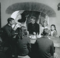 Photograph of Bridget Johnston serving tea to the family.