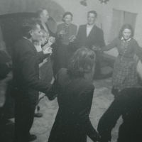 Photograph Irish dancers holding hands in a circle, in a cottage on Inishmore, Aran Islands