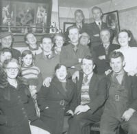 Photograph of 16 persons, the Makem family and neighbours in the Makem home, 42 Victoria St, Keady, Co Armagh