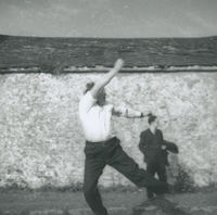 Photograph of Flor Crowley swinging the bowl.