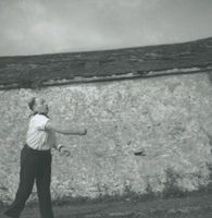 Photograph of Flor Crowley having just thrown the bowl.