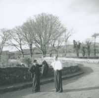 Photograph of Flor Crowley standing in the road talking to a spectator.