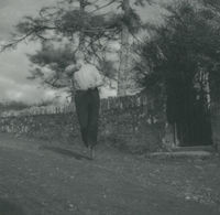 Photograph of Flor Crowley in mid air while road bowling.