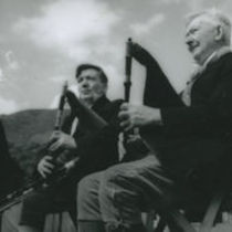 Photograph of Frank and Francis McPeake playing the uileann pipes.