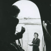 Photograph of a doorway of a plane with a woman, at Dublin Airport.