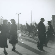 Photograph of pedestrians and cyclists crossing a junction at O'Connell Bridge, Dublin