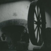 Photograph of man and woman sitting by the hearth, Aran Islands.