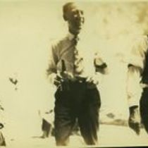 Photograph of man holding a glass bottle