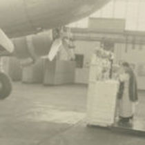 Photograph of a priest at the altar taking mass in a hangar at Dublin Airport