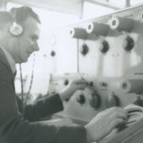 Photograph of a man at work in the control tower at Dublin Airport