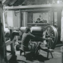 Photograph of a young woman spinning, Aran Islands.