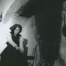 Photograph of Bridget Johnston sitting by the hearth.