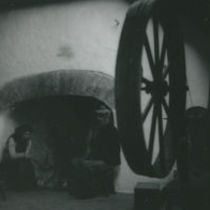Photograph of woman and a man sitting by the hearth, Aran Islands.